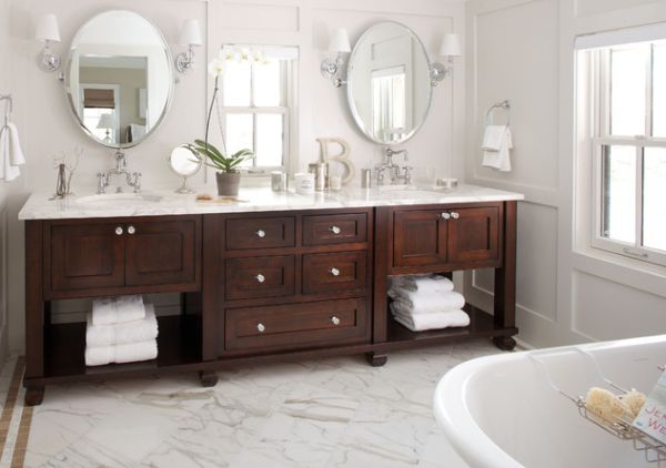 Exquisite-bathroom-vanity-in-dark-tones-complements-the-pristine-white-backdrop